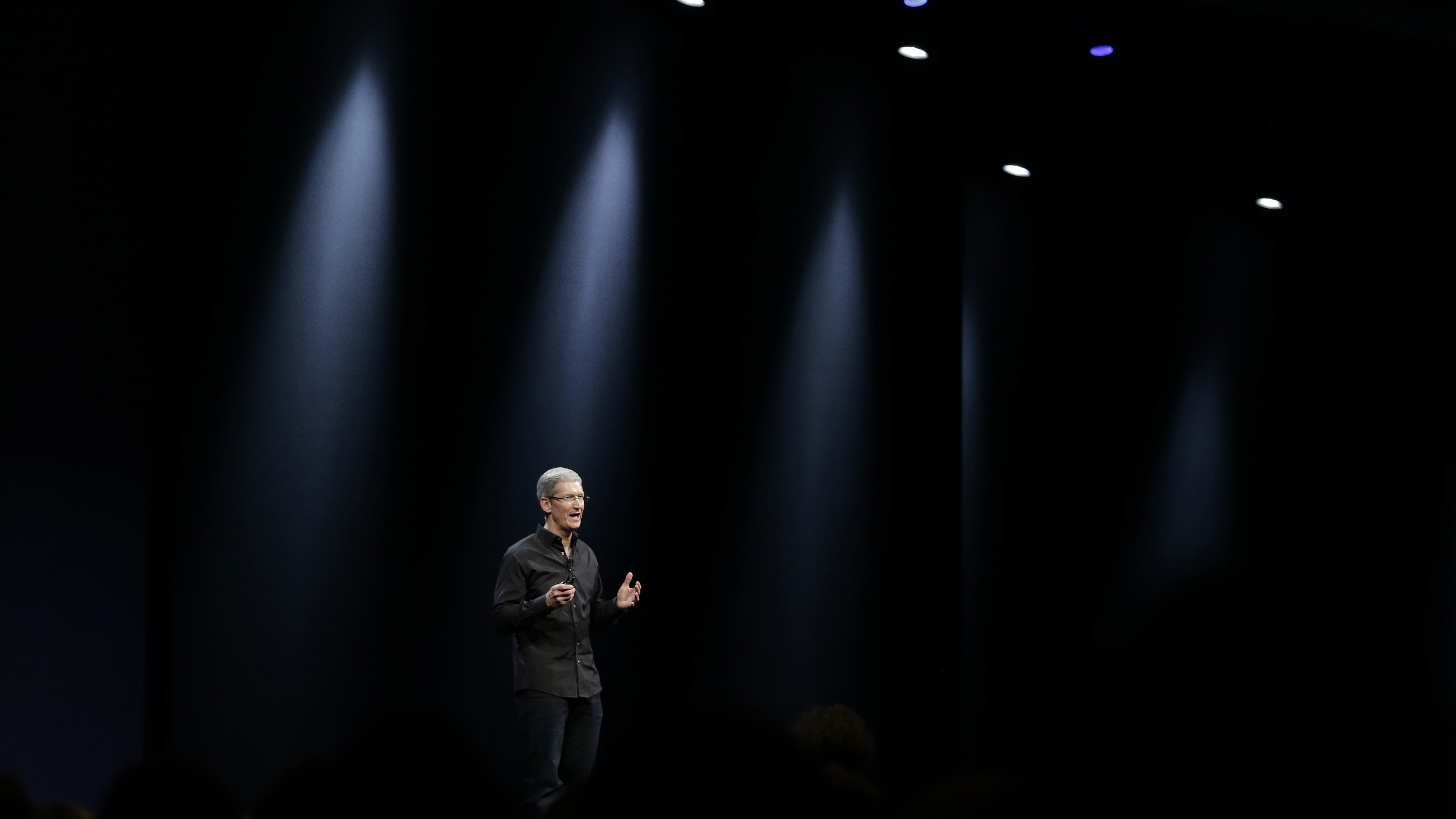 Apple CEO Tim Cook during the keynote address of the Apple Worldwide Developers Conference WWDC Monday, June 10, 2013 in San Francisco. (AP Photo/Eric Risberg)