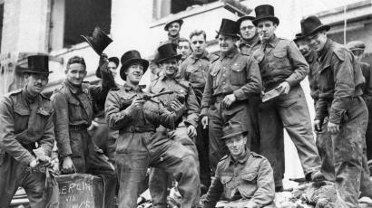 A group of rescue workers don hats found in the wreckage of a shop, near Liverpool Street station, in London, in this undated file photo.
