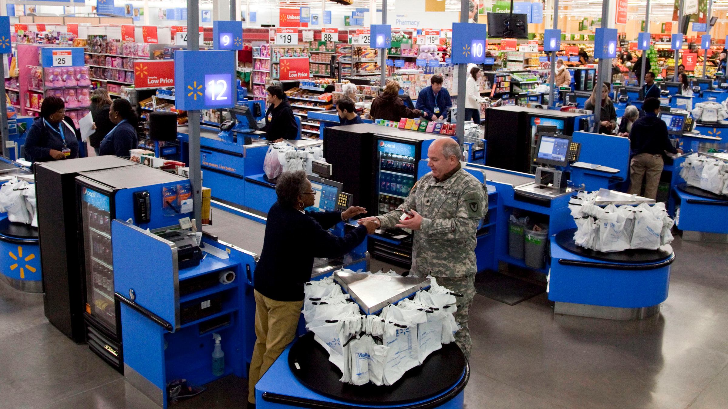 In this photo taken Dec. 15, 2010, the check-out inside a Wal-Mart store in Alexandria, Va., is shown. The battleground for the biggest fight in retailing today is being played out along this suburban highway. Going head-to-head: Wal-Mart against everyone else.
