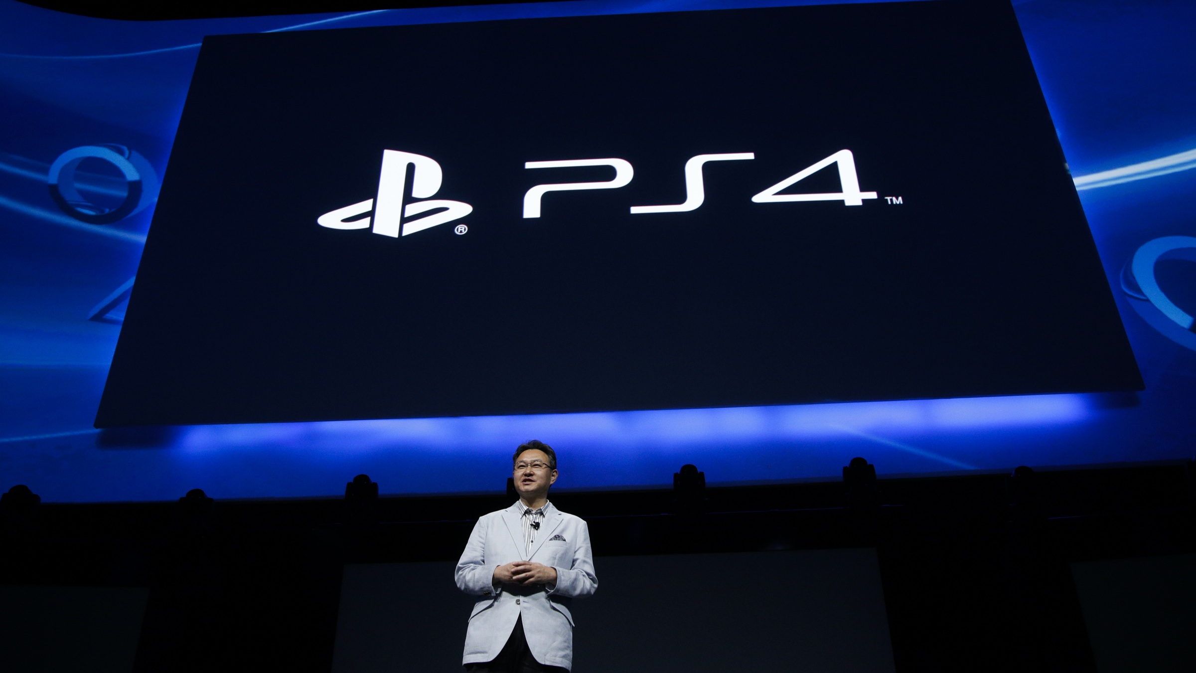 Shu Yoshida, president of Sony's Worldwide Studios for Sony Computer Entertainment Inc., addresses the media at the Sony PlayStation E3 media briefing in Los Angeles, Monday, June 10, 2013. Sony is giving gamers their first look at the PlayStation 4 and it's a rectangular black box, just like all the previous PlayStations. (AP Photo/Jae C. Hong)