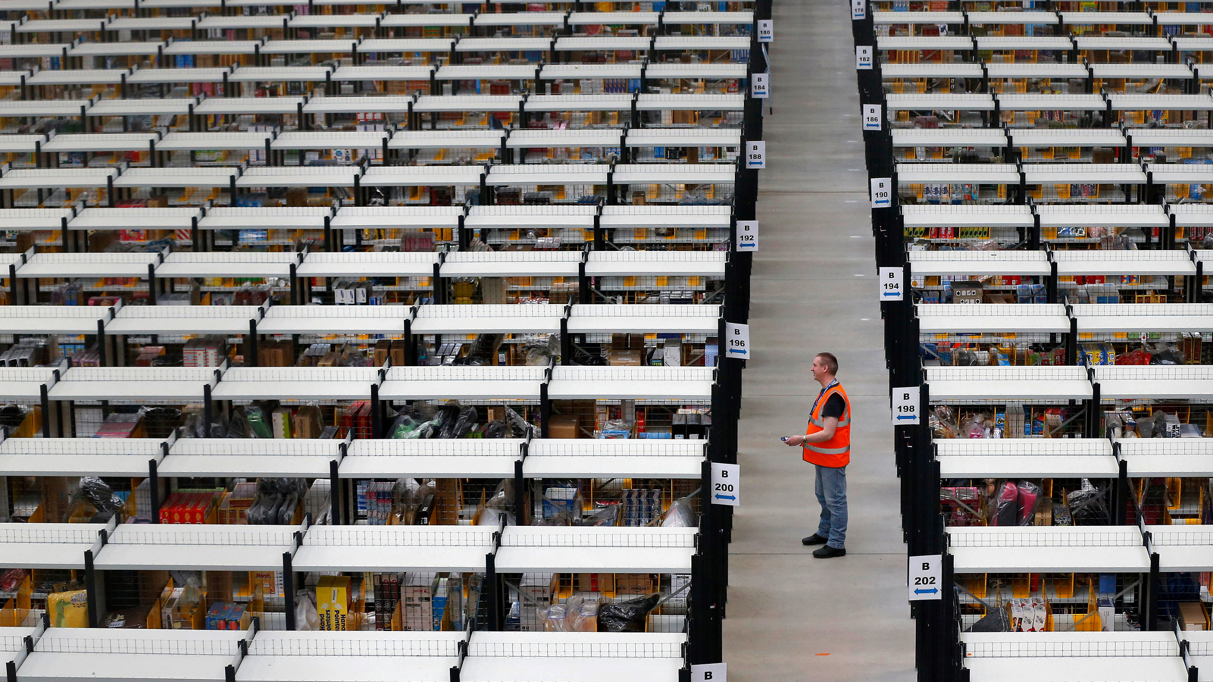 Workers collect orders at Amazon's fulfilment centre in Rugeley, central England December 11, 2012.
