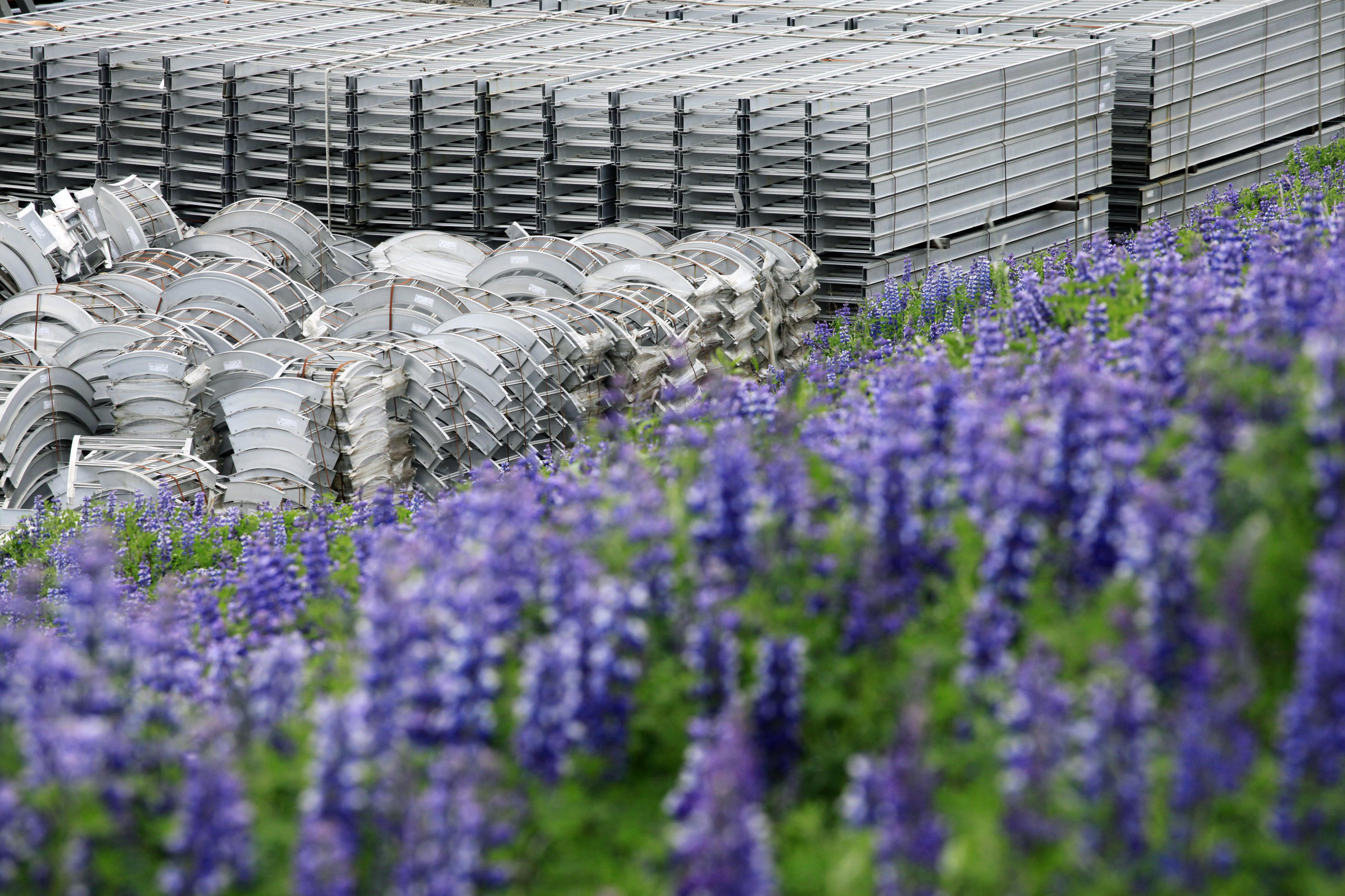 Stacks of fabricated aluminum are stored at Alcoa's Fjardaal aluminum smelter in Reydarfjordur, Iceland, July 5, 2011. The environmentally friendly plant utilizes hydroelectric power. (AP Photo/Mark Lennihan)