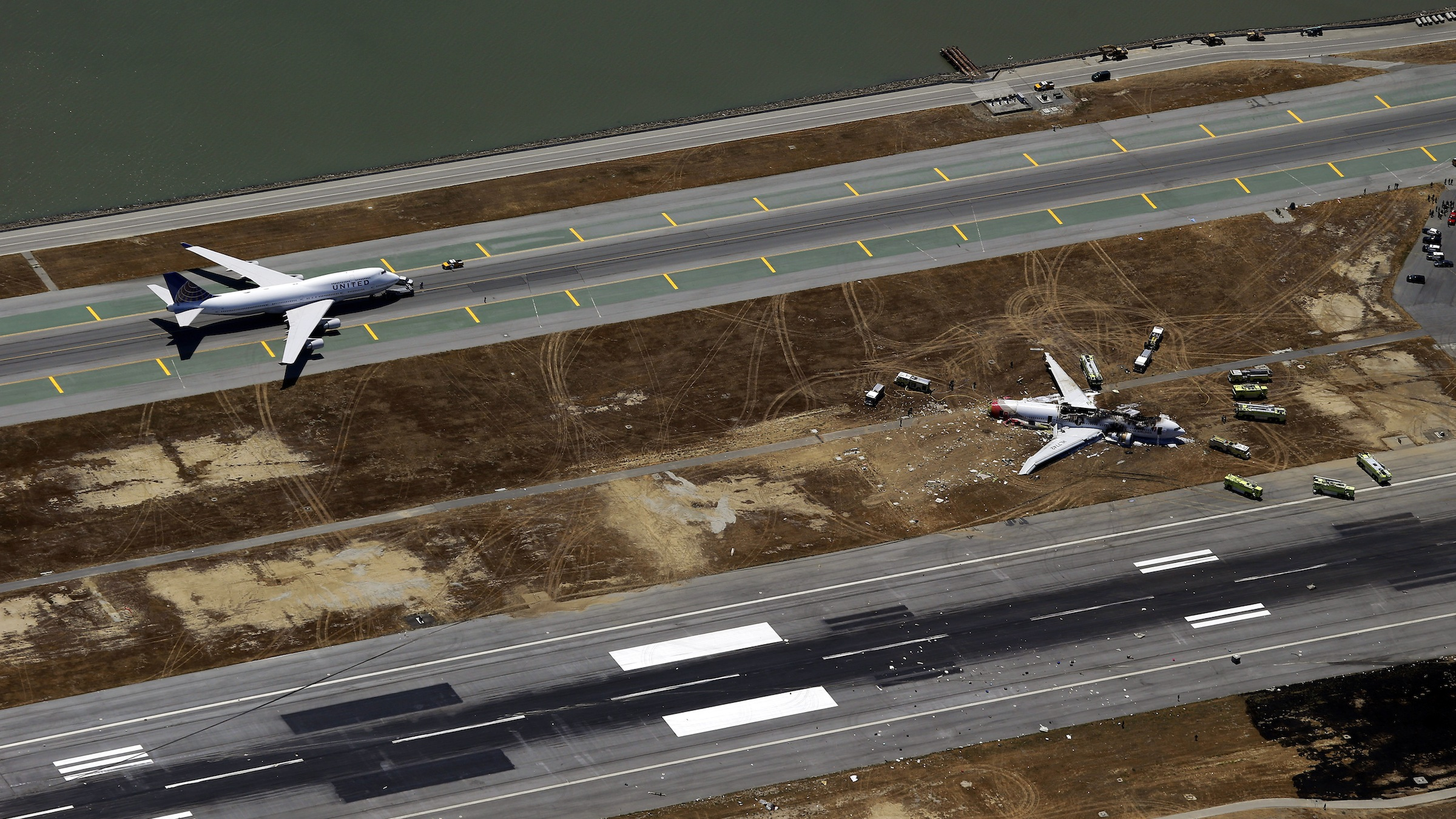 This aerial photo shows the crash site of Asiana Flight 214 at the San Francisco International Airport in San Francisco, Saturday,  July 6, 2013. (AP Photo/Marcio Jose Sanchez)