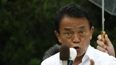 Japanese Prime Minister and leader of the ruling Liberal Democratic Party Taro Aso makes a speech at a campaign for the upcoming lower house election in Isahaya, southwestern Japan, August 28, 2009. Frustrated Japanese voters look set to sweep the opposition to victory in Sunday's election, but the novice Democratic Party will quickly face the challenge of an economy suffering from record jobless rates and deflation. REUTERS/Toru Hanai