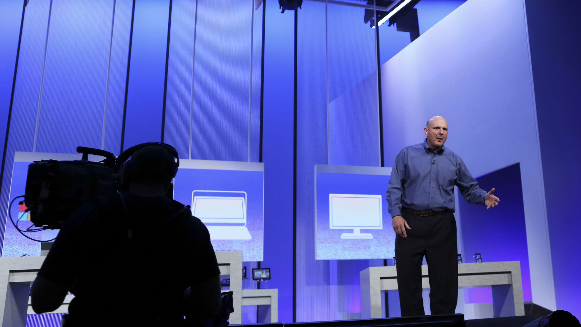"Microsoft CEO Steve Ballmer gestures during his keynote address at the Microsoft ""Build"" conference in San Francisco, California June 26, 2013."