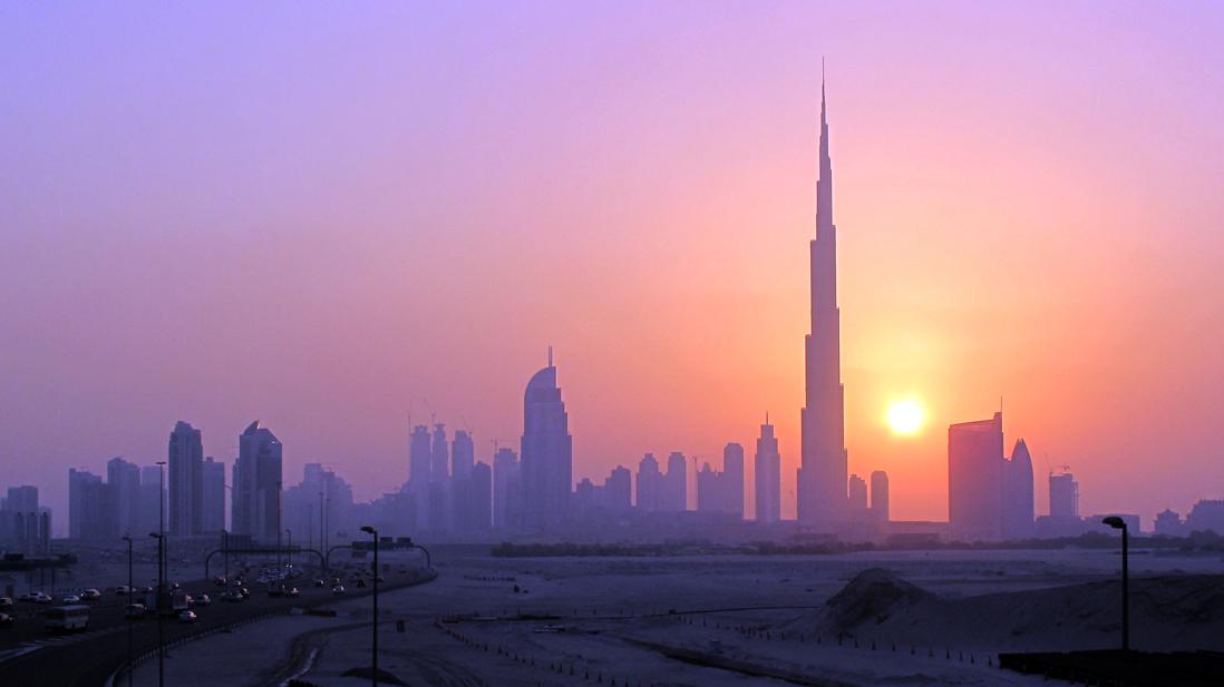 The Burj Khalifa (C) skyscrapper is seen as the sun sets over Dubai, October 5, 2010. REUTERS/Mosab Omar
