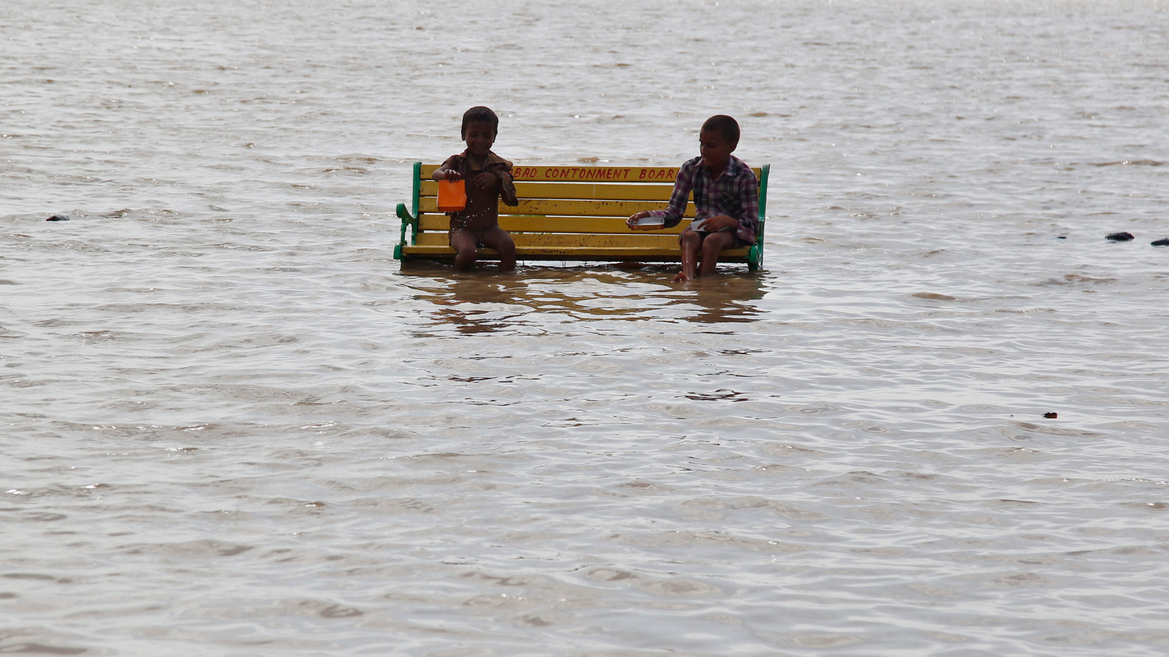 Children sit on floating bench