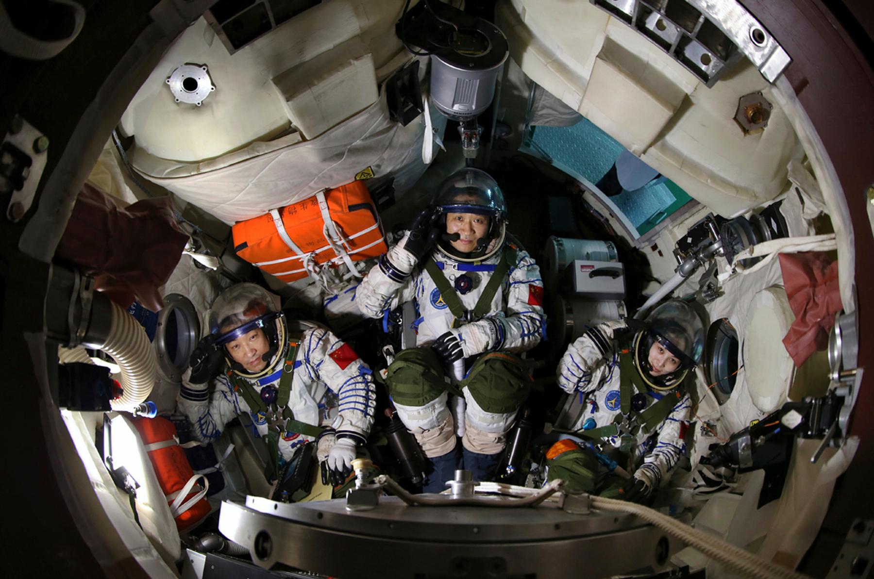 Chinese astronauts (from L to R) Zhang Xiaoguang, Nie Haisheng and Wang Yapin