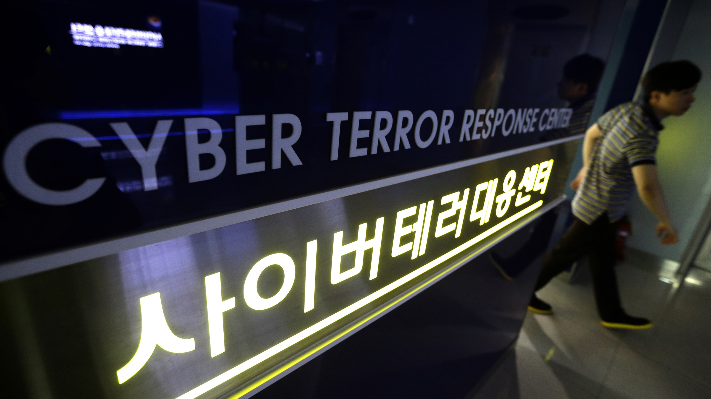 EMBARGOED UNTIL 12:01 JULY 9, 2013 PST (0700 GMT), HOLD FOR USE WITH STORY SLUGGED SOUTH KOREA CYBERATTACKS KOREA BY YOUKYUNG LEE and MARTHA MENDOZA, A man walks by a sign at Cyber Terror Response Center of National Police Agency in Seoul, South Korea, Friday, July 5, 2013. (AP Photo/Lee Jin-man)
