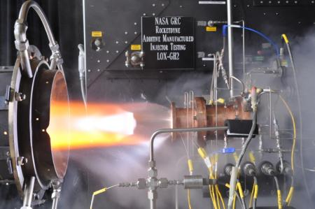 Liquid oxygen/gaseous hydrogen rocket injector assembly built using additive manufacturing technology is hot-fire tested at NASA Glenn Research Center's Rocket Combustion Laboratory in Cleveland, Ohio.