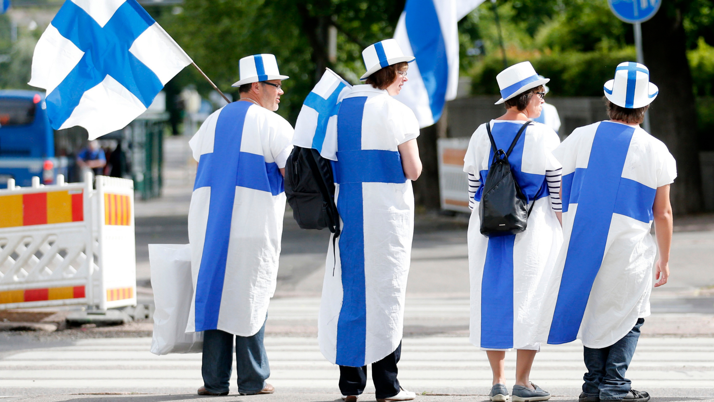 Finnish fans dress in their national colours and hold Finnish flags at the European Athletics Championships in Helsinki.