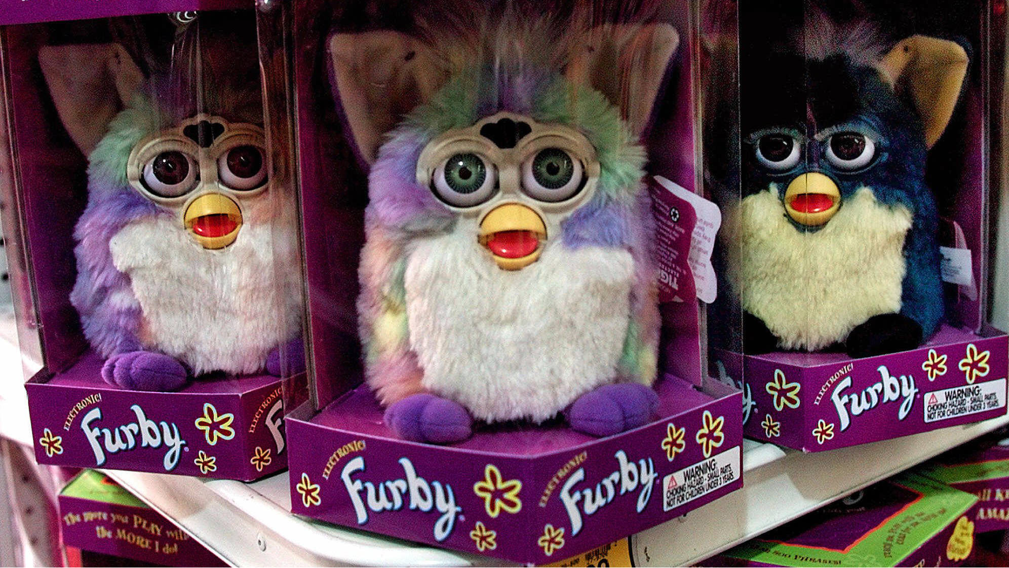 A display of Furby dolls, an interactive children's toy, is seen on display at a Toys 'R' Us store in Glendale, Calif., Wednesday, Sept. 29, 1999. The Sept. 21 earthquake that devastated parts of Taiwan is sending tremors through the toy and personal computer industries, which rely on Taiwanese semiconductors for products ranging from personal computers to interactive Furby dolls. (AP Photo/Damian Dovarganes