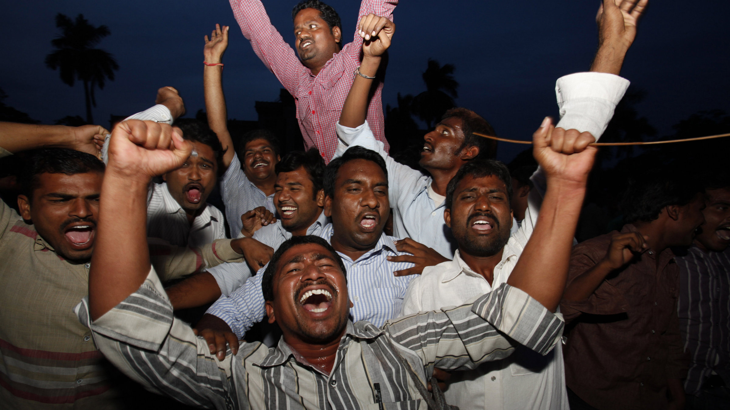 Students of Osmania University celebrate after India's ruling coalition endorsed the creation of the new state.