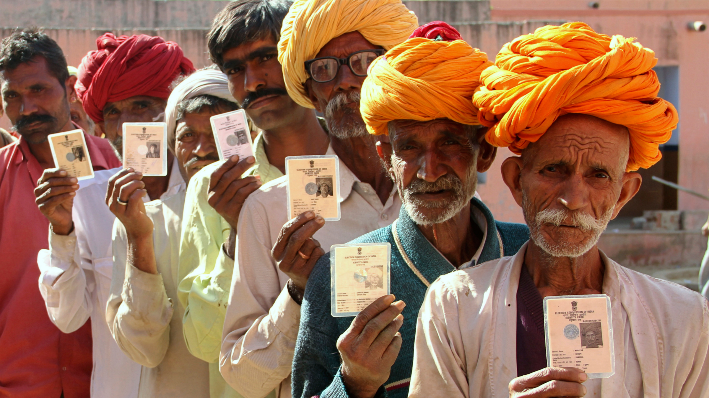 Crowds holding unique id cards in India