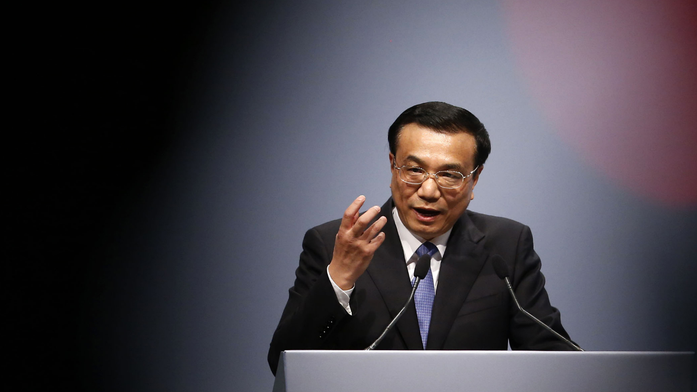 Chinese Premier Li Keqiang makes a point during his speech among a meeting with German Economy Minister Philipp Roesler in Berlin May 27, 2013. REUTERS/Tobias Schwarz