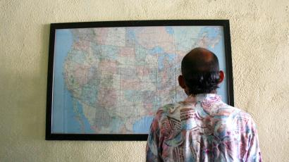 Migrant looks at map of US