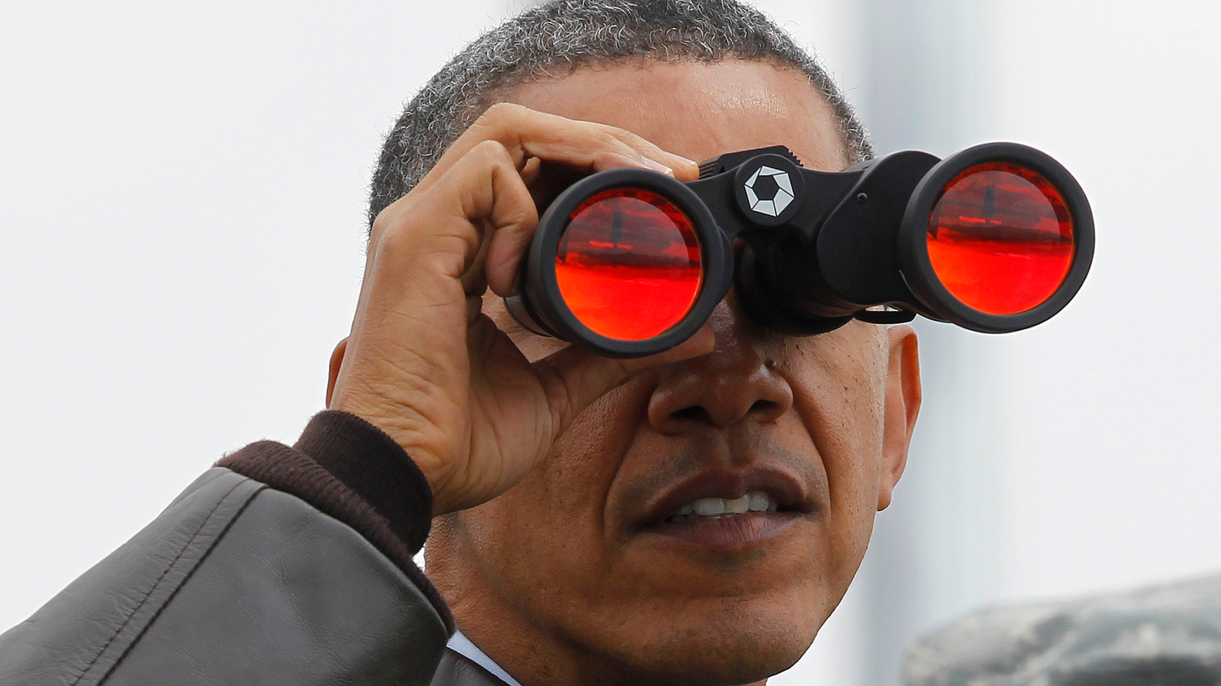 President Barack Obama looks through binoculars to see North Korea from Observation Post Ouellette in the Demilitarized Zone, the tense military border between the two Koreas, in Panmunjom, South Korea, Sunday, March 25, 2012.