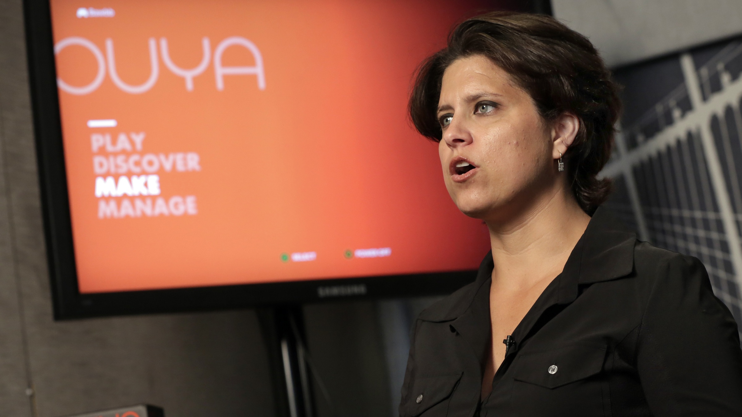 Julie Uhrman, chief executive of Android game console maker Ouya, is interviewed in New York, Tuesday, June 25, 2013.  Ouya, that went on sale Tuesday for $99, aims to challenge the dominance of the Xboxes, Nintendos and PlayStations of the world. The launch follows a successful funding campaign through the group-fundraising site Kickstarter, but it's unclear whether the console will enjoy broader success. (AP Photo/Richard Drew)
