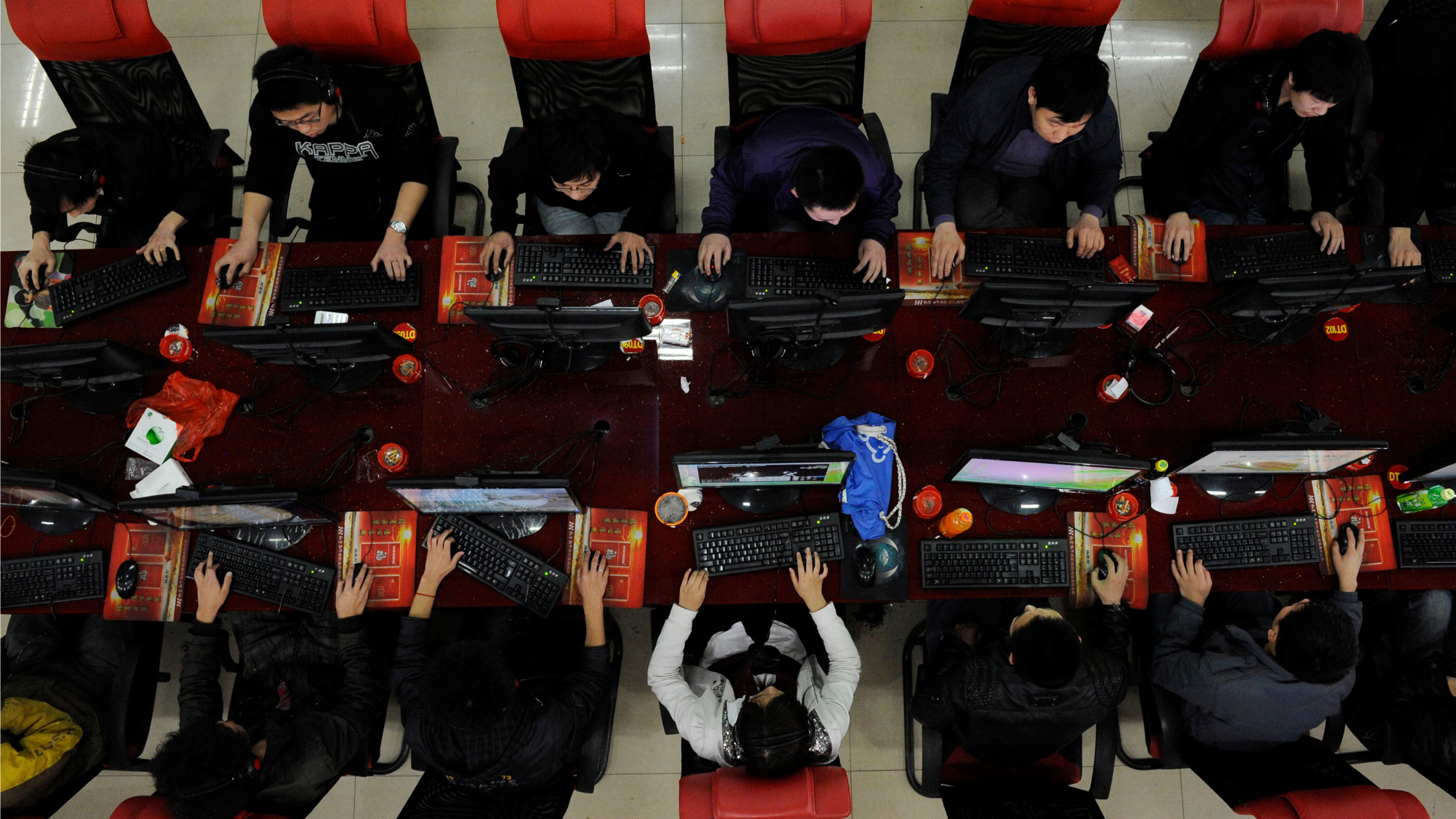People use the computer at an Internet cafe in Taiyuan, Shanxi province.