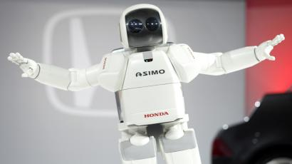 Honda's intelligent humanoid robot, shows his realistic movements during press days at the North American International Auto Show in Detroit, Michigan, anuary 5, 2004. Using new advanced motion technology, ASIMO not only walks forward and backward, but also turns sideways, climbs up and down stairs and turns corners. REUTERS/Gregory Shamus