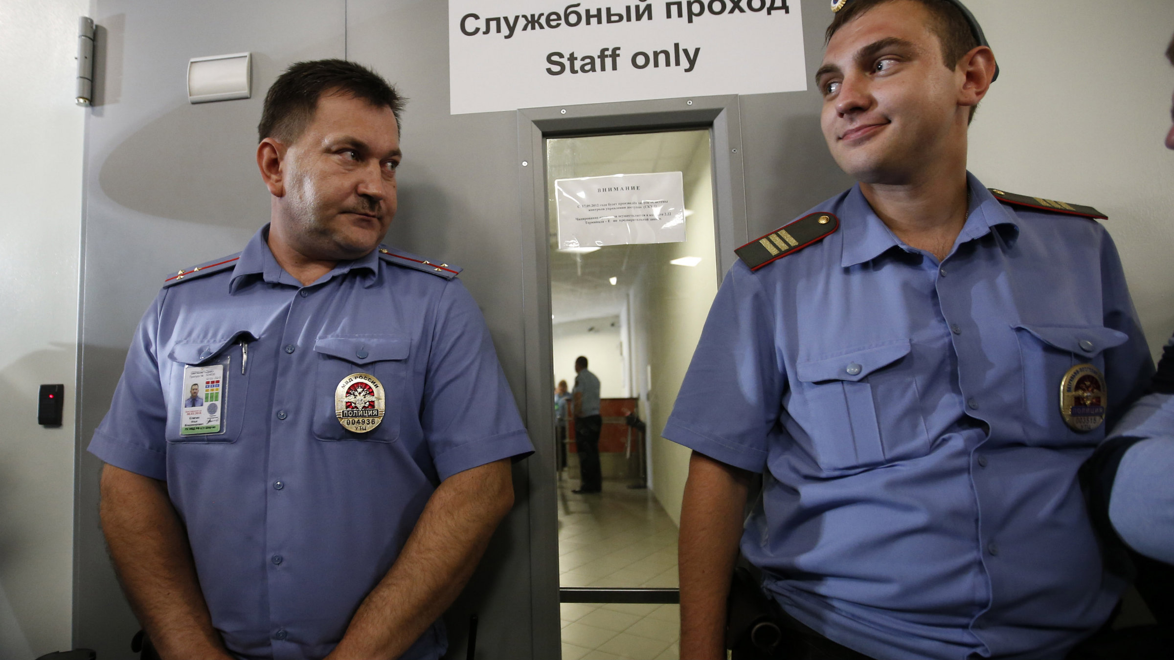 Russian police guarded Snowden's airport meeting.