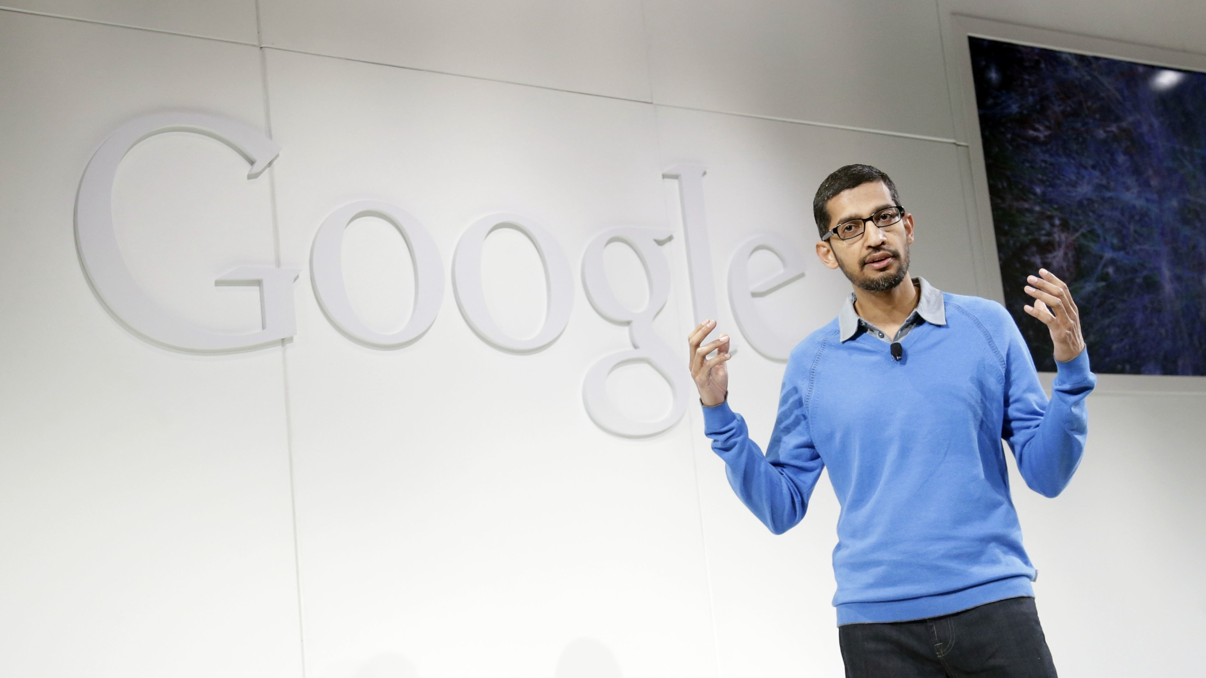 Sundar Pichai, senior vice president Chrome and apps for Google, speaks on Wednesday, July 24, 2013, in San Francisco. (AP Photo/Marcio Jose Sanchez)