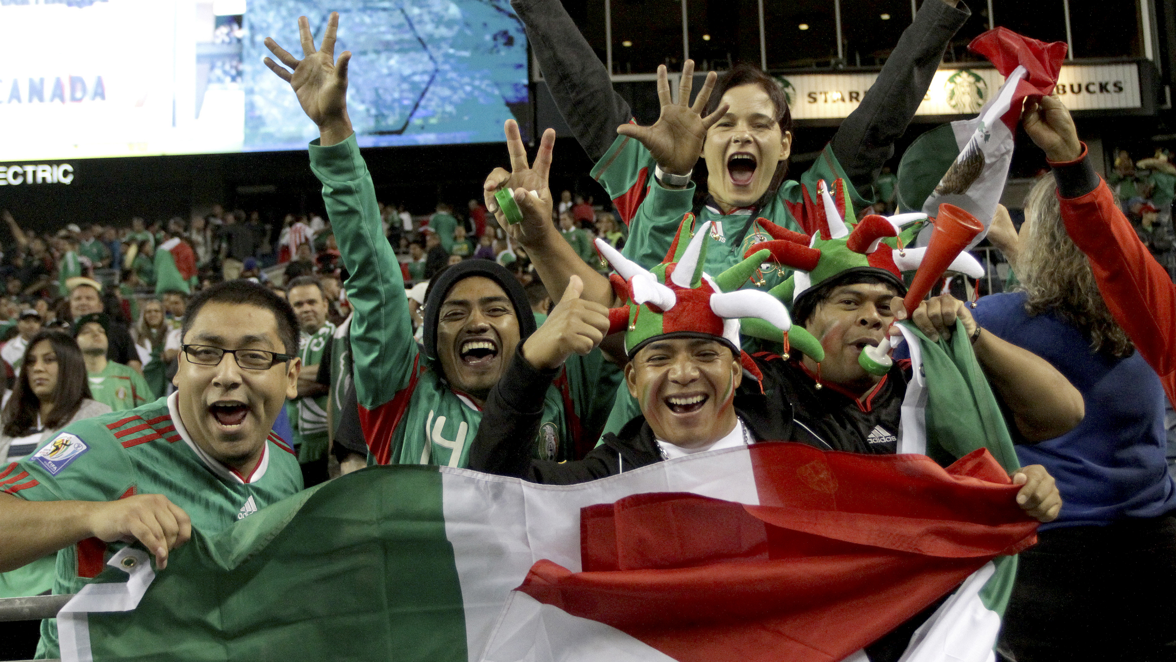 exico fans celebrate the win over Canada in their CONCACAF Gold Cup soccer match in Seattle, Washington July 11, 2013. REUTERS/Marcus Donner