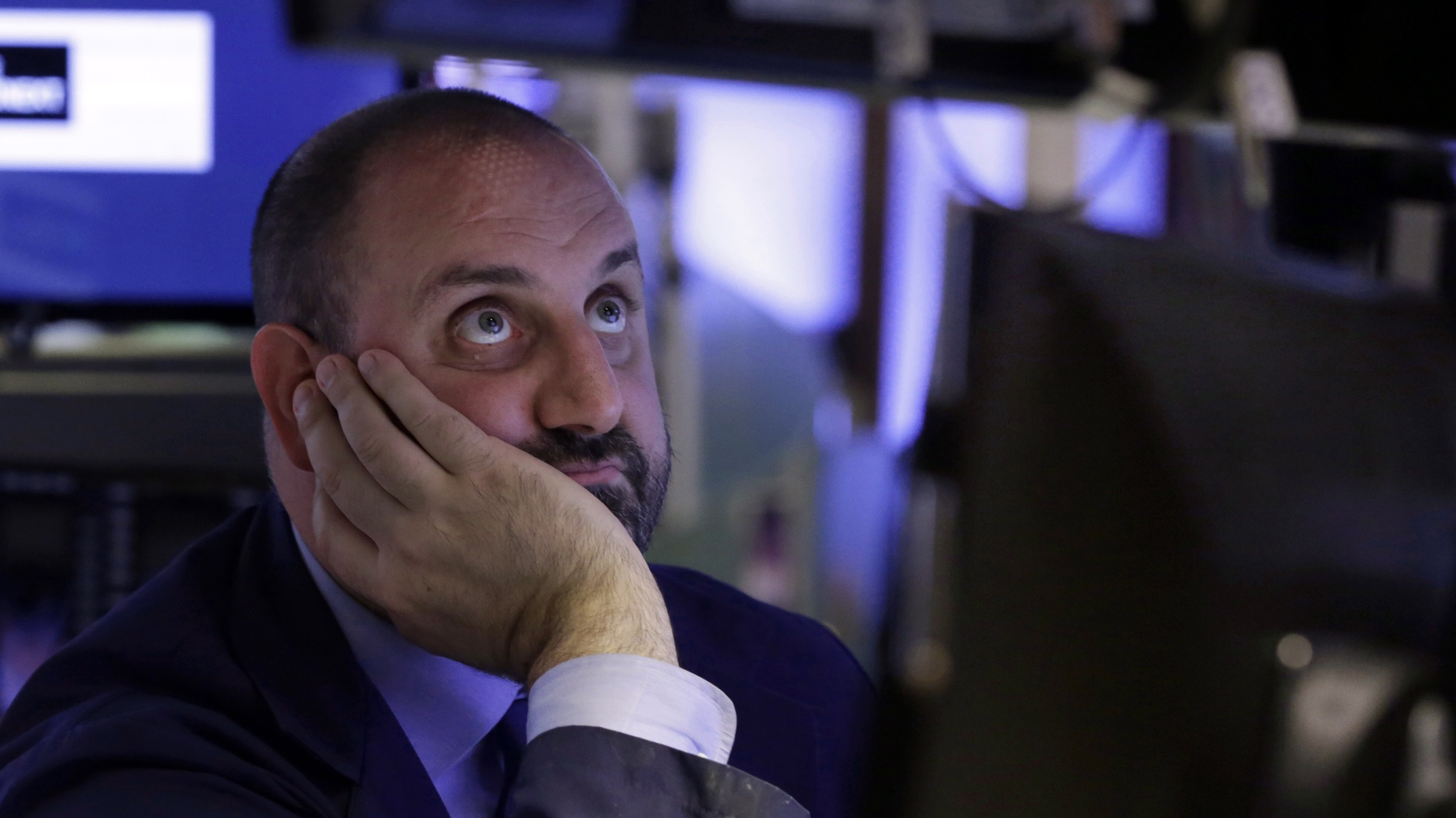 Specialist Peter Giacchi watches his screens as he works on the floor of the New York Stock Exchange, Monday, June 24, 2013. Traders in the U.S. dumped stocks, bonds and commodities, prompted by signs of distress in China's economy and worries about the end of the Federal Reserve bank's easy money policies. (AP Photo/Richard Drew)