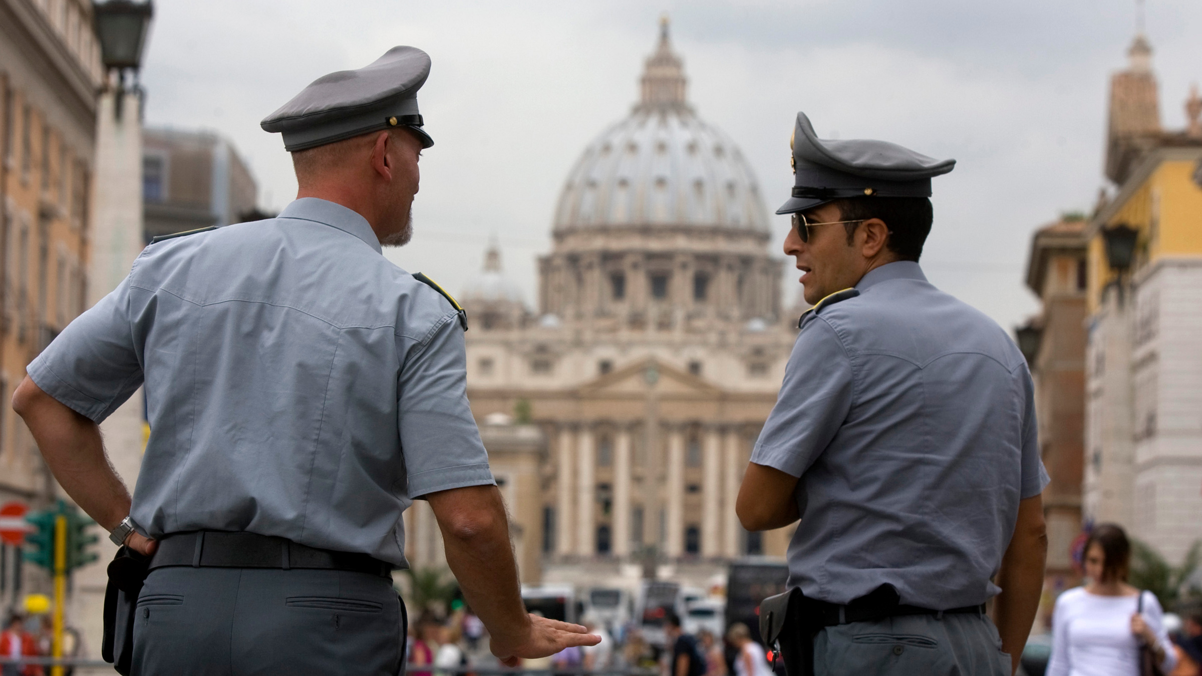 """In this Tuesday, Sept. 21, 2010 file photo Italian financial Police officers talk to each other in front of St. Peter's square at the Vatican. A Rome court has upheld the seizure of €23 million (€31 million) from a Vatican bank account, and the Holy See is expressing """"astonishment"""" over the decision. Vatican spokesman the Rev. Federico Lombardi says the Holy See """"learned of the ruling with astonishment."""" Lombardi said Wednesday, oCT. 20, 2010 that Vatican bank officials maintain they can clarify the matter soon. The seizure last month was based on alleged violations of Italy's laws against money laundering. Lombardi indicated that the Vatican is contending the problem is a matter of how the regulations are interpreted."""