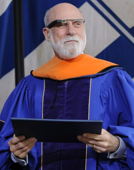 Wearing Google Glass, computer scientist Vinton Cerf holds his honorary degree of Doctor of Engineering and Technology during commencement at Yale University in New Haven, Conn., Monday, May 20, 2013. Cerf is considered as one of the fathers of the internet. (AP Photo/Jessica Hill)