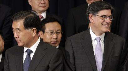 Chinese Vice Premier Wang Yang (L) and U.S. Treasury Secretary Jack Lew participate in the family photo during the U.S.-China Strategic and Economic Dialogue (S&ED) at the State Department in Washington July 10, 2013. REUTERS/Yuri Gripas