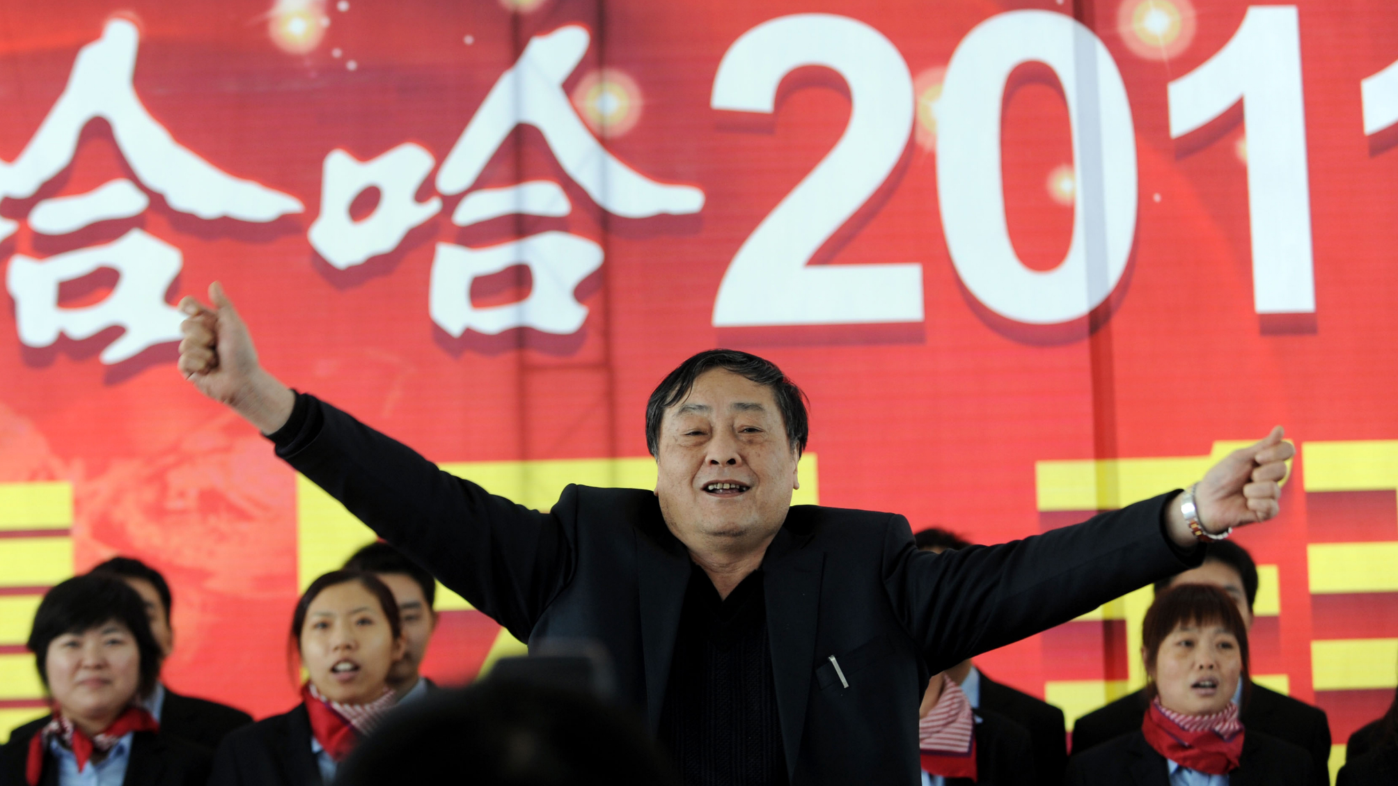 Zong Qinghou, center, Chairman and CEO of Wahaha Group, sings with his employees to celebrate the Spring Festival at a plant of Wahaha in Hangzhou city, east Chinas Zhejiang province, 2 February 2011. Chinas richest man, Zong Qinghou, may be known for his frugality, but he bailed on two free dinners in February, snubbing invitations from Britains Queen Elizabeth and Prime Minister David Cameron. The queen invited me for February 6; the prime minister invited me for the 12th. Lunar New Year was on the 9th, the founder of Chinas third-largest beverage maker Wahaha told China Entrepreneur Magazine in an interview published on Sunday (5 May 2013). Should I have flown for more then 10 hours, eat and travel back, then fly once again, eat and fly back? he asked. That doesnt make any sense. The invitation from Buckingham Palace could not be confirmed through the official Court Circular, which lists royal engagements. The queen and the prince of Edinburgh did not have any public engagements on February 6, and the prince of Wales met only a eurosceptic House of Lords cross-bencher. On February 12, Downing Street hosted an annual Chinese New Year Reception, at which David Cameron wished xin nian kuai le to the Chinese community in Britain.(Imaginechina via AP Images)