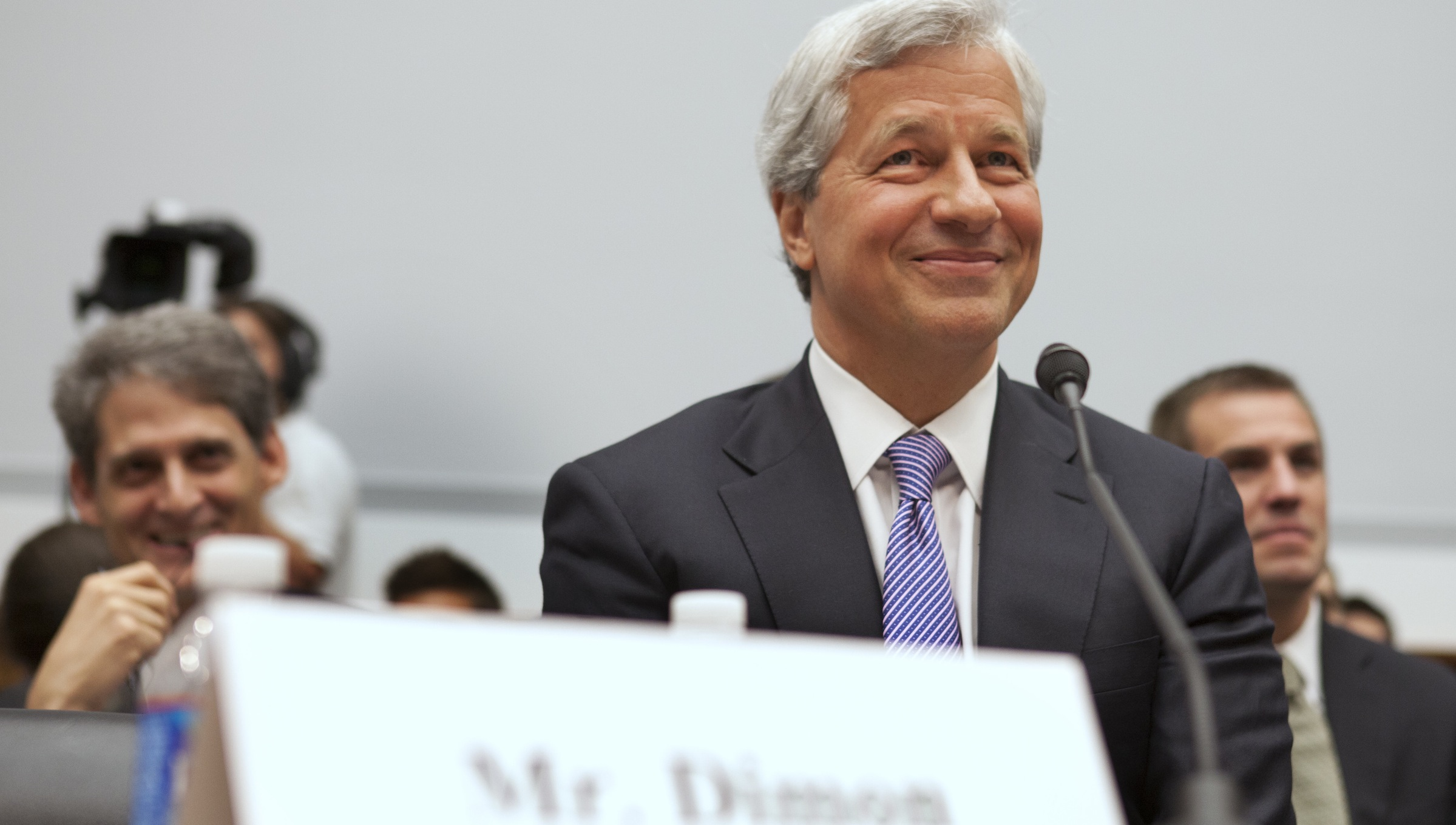 Jamie Dimon, CEO of JPMorgan Chase, smiles while testifying before the House Financial Services Committee on Capitol Hill in Washington, on Tuesday, June 19, 2012. (AP Photo/Jacquelyn Martin)