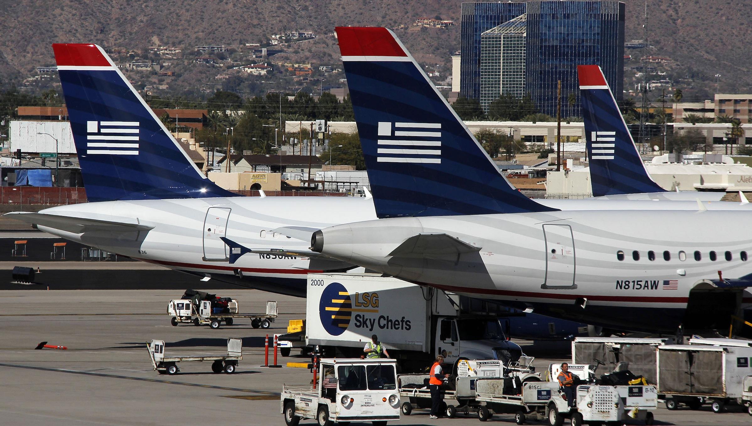 This March 1, 2013 photo shows  USAirways Airbus aircraft at Phoenix Sky Harbor International Airport. (AP Photo/Gene J. Puskar, File)