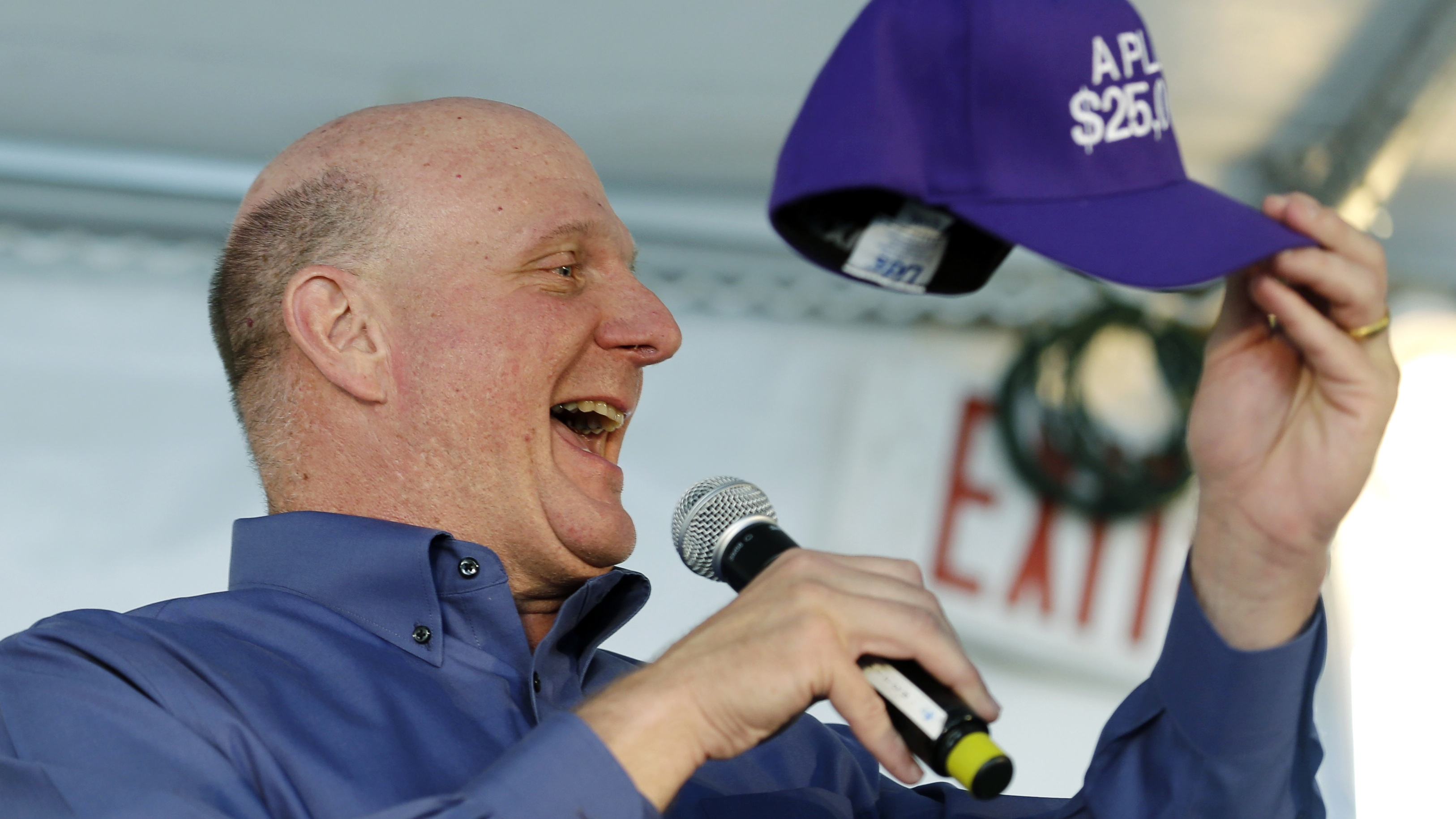 """Microsoft Chairman Steve Ballmer holds up a cap representing a $25,000 donation to the A PLUS youth program, Thursday, April 25, 2013, during a fundraising luncheon in Seattle. Ballmer, who is part of the group attempting to purchase the Sacramento Kings NBA basketball team and move them to Seattle, said Thursday he believes """"there will never be a better opportunity"""" than now to bring back professional basketball to the Puget Sound. Ballmer said he made the donation to give the cap to Chris Hansen, a hedge-fund manager who is heading up the effort to purchase the Kings. (AP Photo/Ted S. Warren)"""