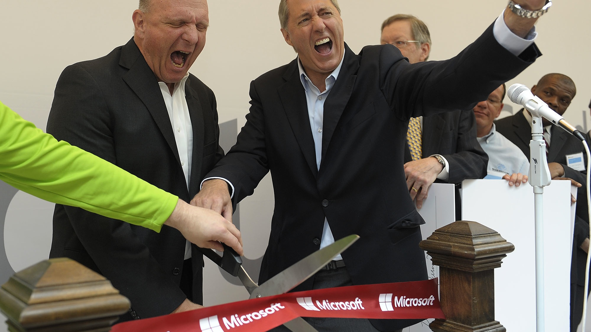 From left, Steve Ballmer, CEO of Microsoft, and John P. Fikany, Microsoft's General Manager of the Heartland District, celebrate after the ribbon cutting to open the new Microsoft store in Troy, Mich. Friday, June 28, 2013. (AP Photo/Detroit News, Clarence Tabb, Jr.)  DETROIT FREE PRESS OUT; HUFFINGTON POST OUT