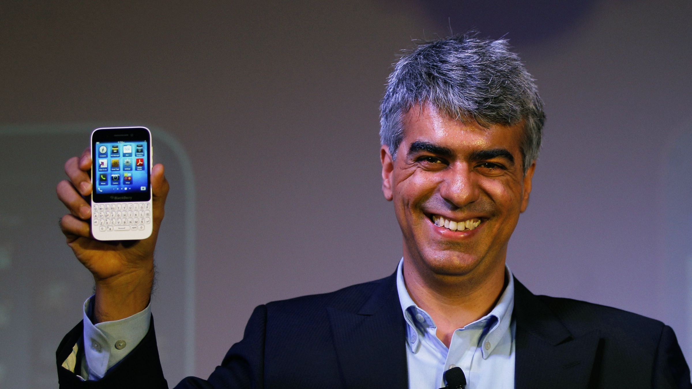 BlackBerry India Managing Director Sunil Lalwani displays BlackBerry Q5 smartphones during its launch in New Delhi, India, Tuesday, July 16, 2013. BlackBerry Q5 is priced at Rupees 24,990 ($416). (AP Photo/Altaf Qadri)
