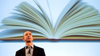 Jeff Bezos, founder and CEO of Amazon.com, uses a projected image of a book to introduce the Kindle at a news conference on Monday, Nov. 19, 2007 in New York. The $399 electronic book device will allow downloads of more than 90,000 book titles, blogs, magazines and newspapers.