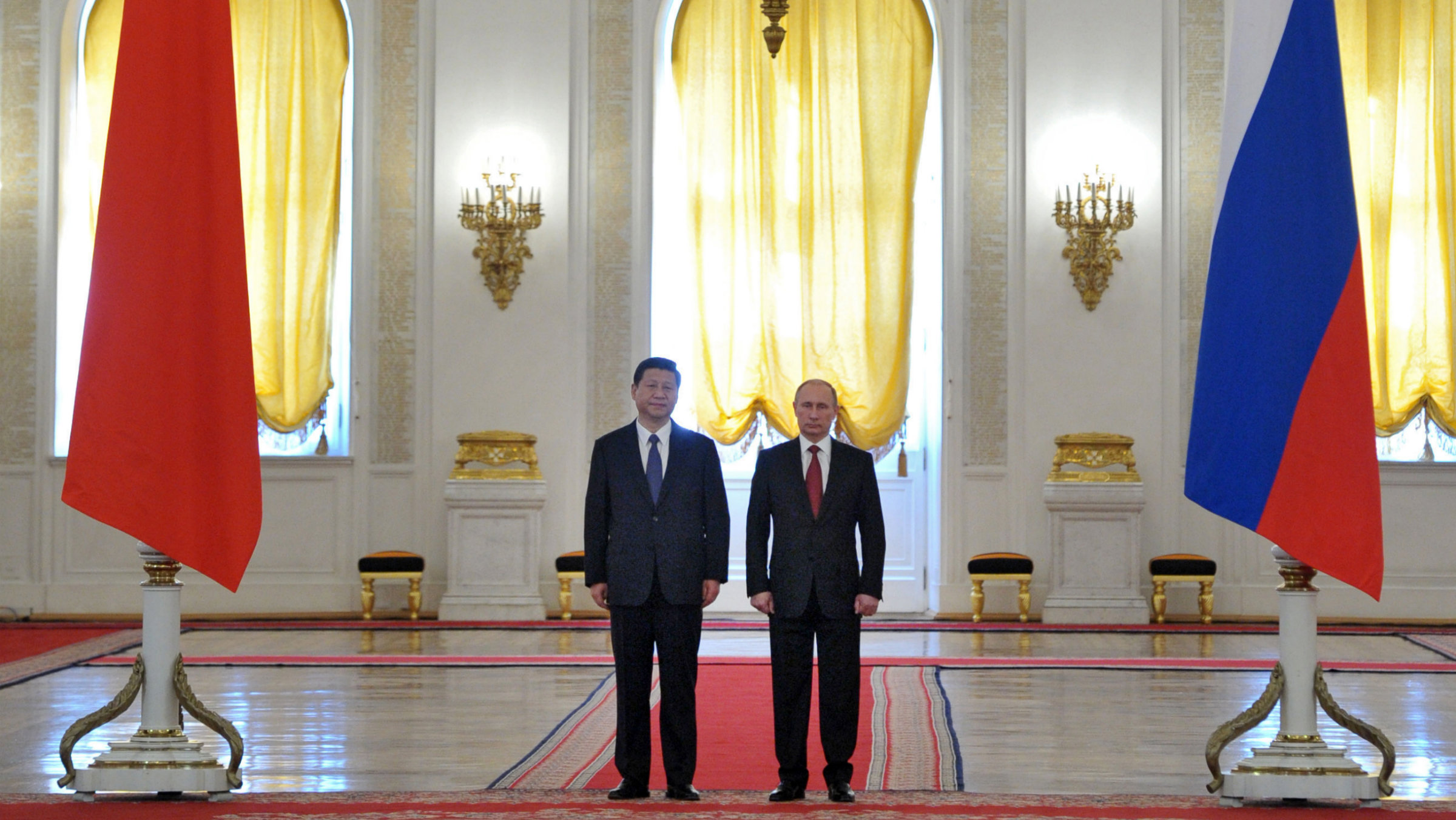 Russian President Vladimir Putin, right, and Chinese President Xi Jinping meet in the Grand Kremlin Palace in Moscow, Russia, Friday, March 22, 2013. Vladimir Putin rolled out a grandiose reception Friday for China's new president, who has chosen Moscow as his first foreign destination, underlining close ties between the former Cold War-era rivals that are anchored in energy interests and a shared aspiration to curtail the U.S. influence. (AP Photo/RIA-Novosti, Alexei Nikolsky, Presidential Press Service,Pool)