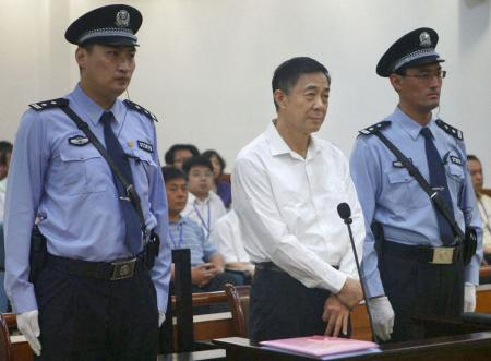 The Jinan Intermediate People's Court's website carries a photo of former Chinese Communist Party rising star Bo Xilai standing trial on charges of taking bribes, embezzlement and abuse of power at the court in Shandong Province on Aug. 22, 2013. (Kyodo via AP Images
