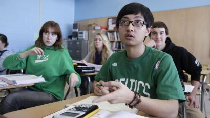 School in Orono, Maine. Minzhe Zou has credited his year at the public school with helping him get accepted to five U.S. colleges. (AP Photo/Robert F. Bukaty
