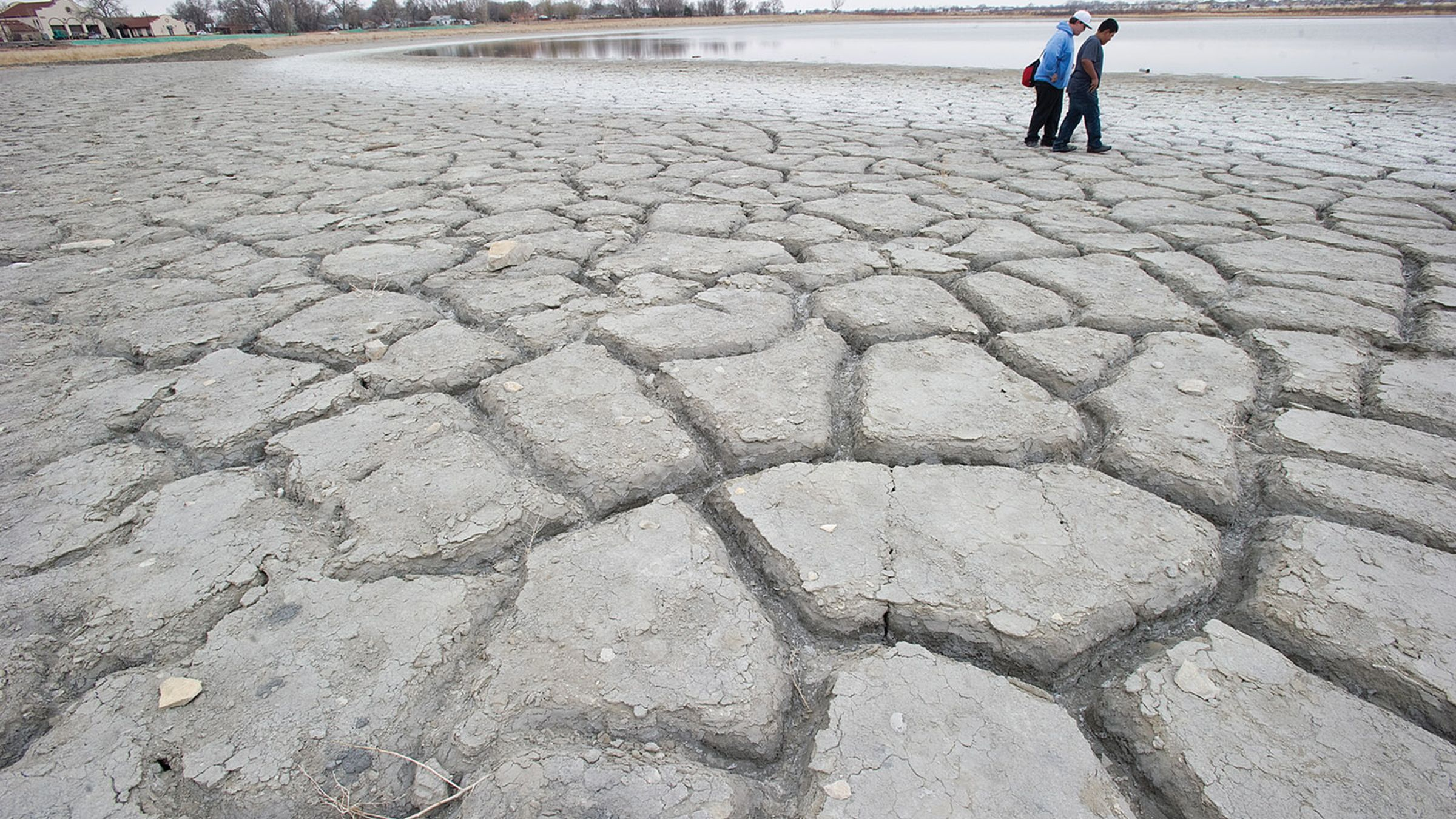 Davis Nixon (left) and Jose Ponce, both 12 years-old, look for fossils on the dry shores of Minnequa Lake in Pueblo, Colo. on April 2, 2013. Lake Minnequa will continue to shrink if the drought persists, even though a pipeline to bring fresh water into the lake is expected to be completed in June. (AP Photo,  John Jaques/Pueblo Chieftain)