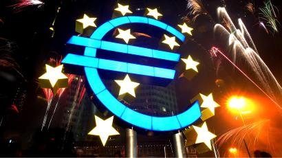 Fireworks illuminate the sky around a huge euro sculpture, designed by German artist Ottmar Hoerl, in front of the headquarters of the European Central Bank (ECB) in Frankfurt, January 1, 2002. Several thousand people in Frankfurt celebrated at a party on the streets around the ECB to welcome Europe's new currency, the euro. UNICS REUTERS/Kai Pfaffenbach