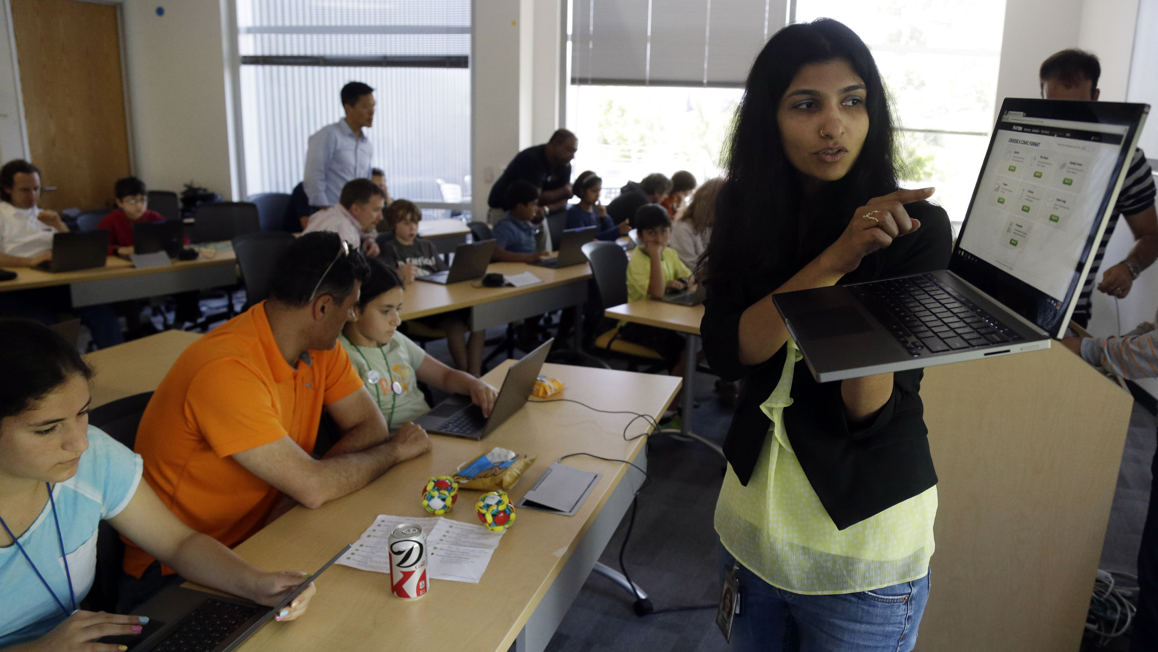 Product manager Vidya Nagarajan demonstrates the new Chrome notebook during a workshop for employees and their children at Google headquarters in Mountain View, Calif., Thursday, April 25, 2013. (AP Photo/Marcio Jose Sanchez)