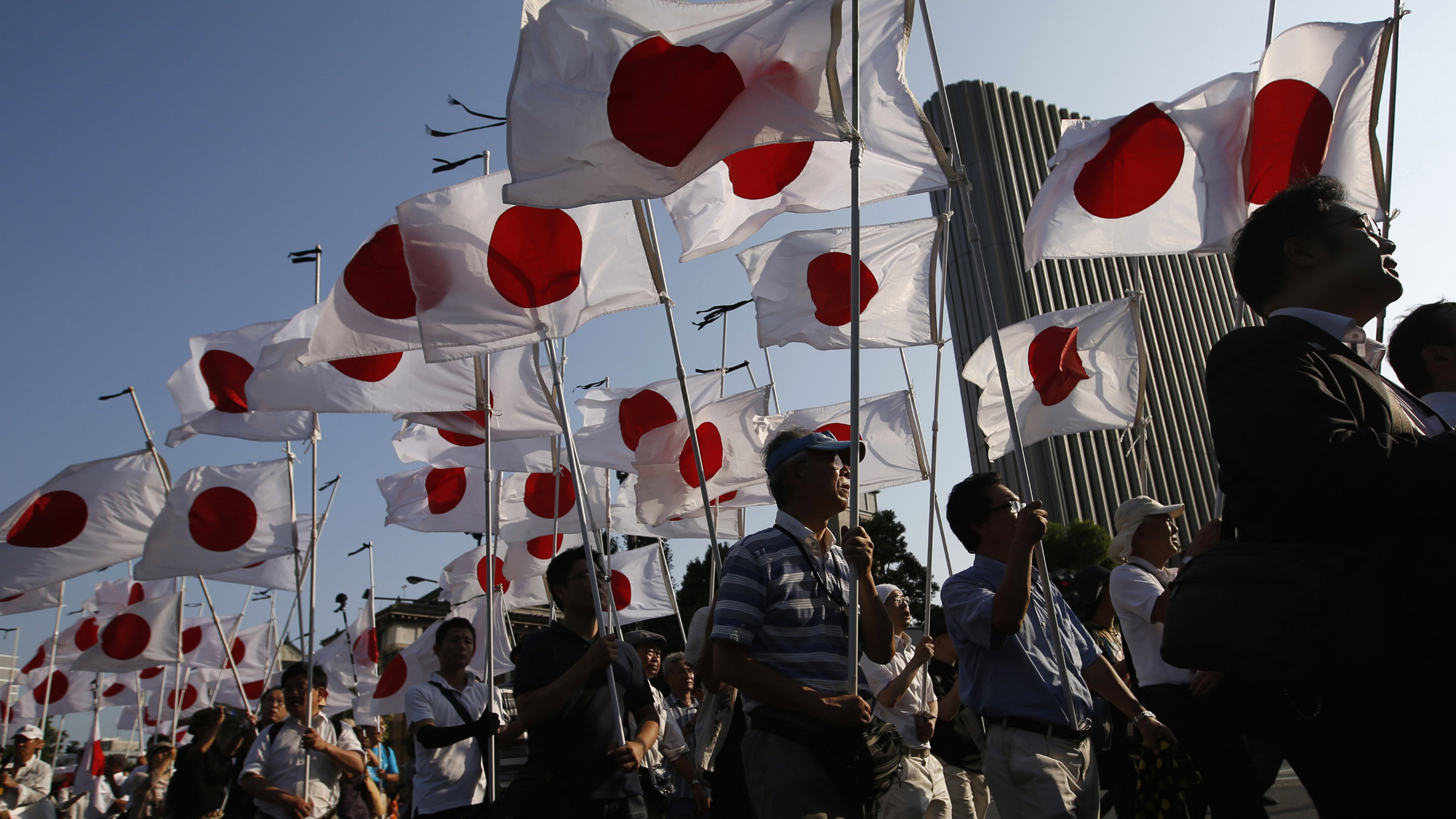 Members of a Japanese nationalist movement march at the Yasukuni Shrine in Tokyo.