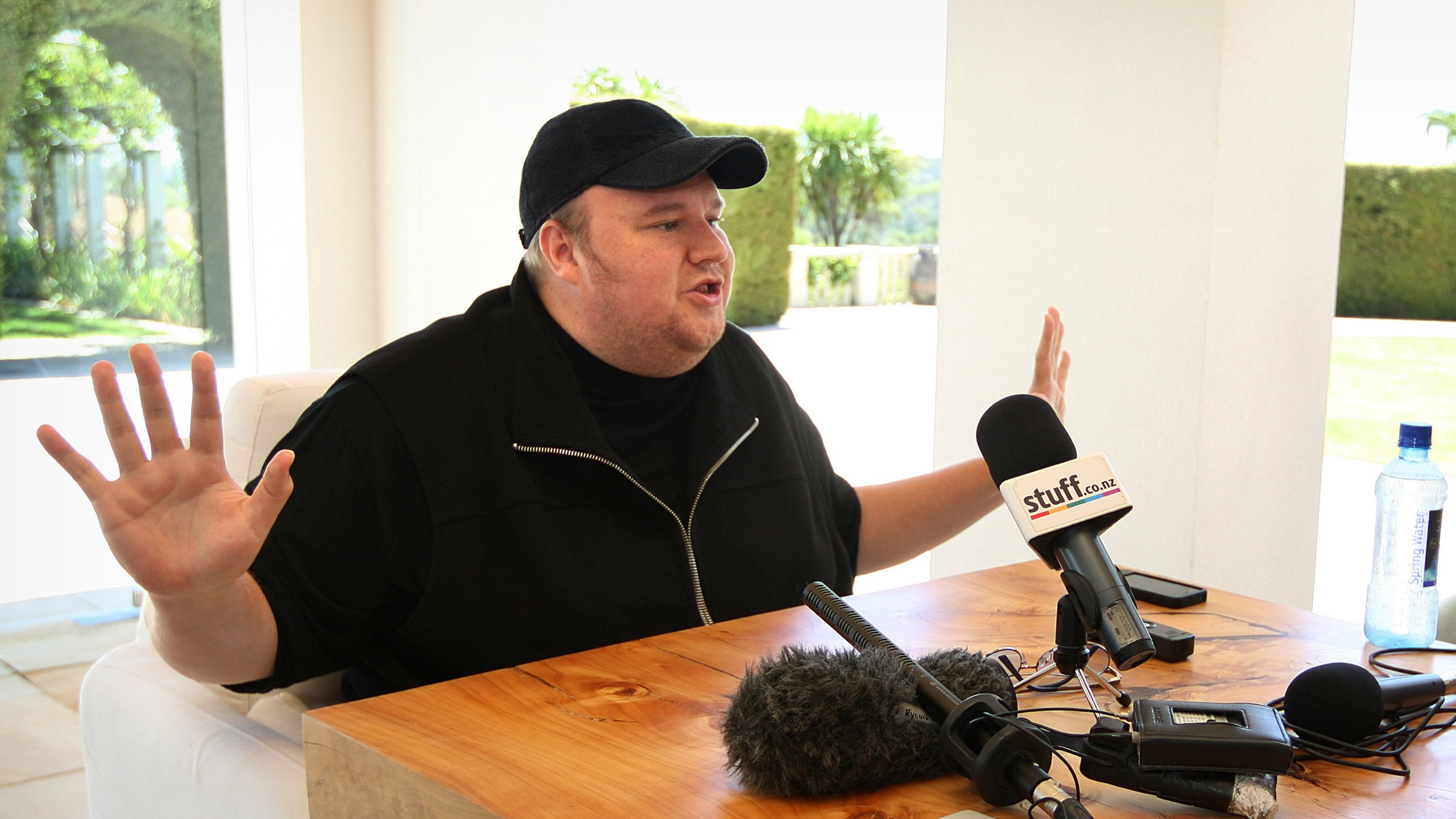 """Indicted Megaupload founder Kim Dotcom holds a press conference ahead of the launch of a new file-sharing website called """"Mega"""" at his Coatesville mansion in Auckland', New Zealand, Sunday, Jan. 20, 2013. The colorful entrepreneur unveiled the site ahead of a lavish gala and press conference on the anniversary of his arrest on racketeering charges related to his now-shuttered Megaupload file-sharing site. (AP Photo/New Zealand Herald, Richard Robinson) New Zealand Out, Australia Out"""