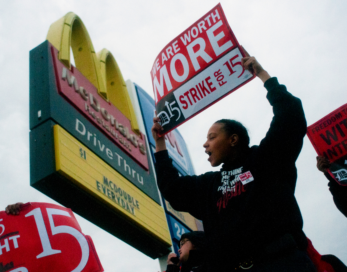 "Fast-food worker Michelle Osborn, 23, of Flint shouts out chants as she and a few dozen others strike outside of McDonald's on Wednesday, July 31, 2013 in Flint. Some fast food restaurant workers have walked off the job in the Detroit area as part of an effort to push for higher wages. Organizers say they began the walkout at restaurants in Lincoln Park and Southfield on Tuesday night. Workers in Flint hit the street Wednesday outside a McDonald's, saying they want wages ""super-sized."" Workers want $15 and hour, better working conditions and the right to unionize. The restaurant industry says higher wages would hurt job creation. The actions follow strikes this week in other parts of the country."