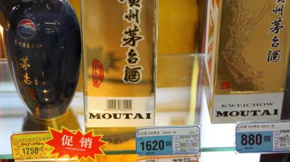 Bottles of Kweichow Moutai liquor are displayed in the counter at a supermarket in Nantong city, east Chinas Jiangsu province, 23 February 2013. Kweichow Moutai Co., Chinas largest maker of baijiu liquor, said first-quarter profit rose 21 percent, less than half the pace of the year-earlier period as President Xi Jinping pushes to curb extravagant spending by government officials. Earnings increased to 3.59 billion yuan (US$582 million) in the three months ended March, according to a company statement to the Shanghai Stock Exchange on Wednesday (17 April 2013). First-quarter earnings rose 58 percent in the year-earlier period. Xis austerity campaign has hurt demand for high-end baijiu, popular at official banquets and for gift giving in China. Moutais sales rose 19 percent to 7.17 billion yuan in the latest quarter, the slowest growth since the third quarter of 2010.(Imaginechina via AP Images