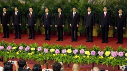 Communist Party General Secretary and Chinese President Hu Jintao, center, stands with the new members of the Politburo Standing Committee, in Beijing's Great Hall of the People Monday Oct. 22, 2007. From left are Public Security Minister Zhou Yongkang, Liaoning Party Secretary Li Keqiang, head of Communist Party Ideology Department Li Changchun, Premier Wen Jiabao, President Hu Jintao, National People's Congress Chairman Wu Bangguo, Chairman of the Chinese People's Political Consultative Conference Jia Qinglin, Shanghai Party Secretary Xi Jinping, and He Guoqiang, the head of the Communist Party Organization Department. The Standing Committee, the inner circle of Chinese political power, was paraded in front of assembled media on the first day following the end of the 17th Communist Party Congress. ((AP Photo/Ng Han Gua