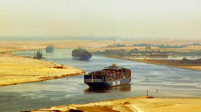 In this photo taken Monday, Sept. 21, 2009, cargo ships sail through the Suez Canal, seen from a helicopter, near Ismailia, in Egypt.